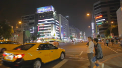 Pedestrians wait for light on dunhua road Stock Footage
