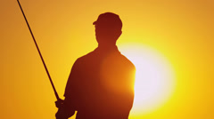 Golf Professional Following Shot Sunset Stock Footage