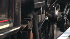 Guard Steam train driver alights his engine with steam surrounding Stock Footage