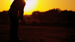 Vacation Golfer Sunset Teeing Off Stock Footage