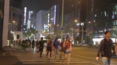 Pedestrians in one of taipei's dunhua district Stock Footage