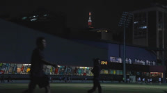 Stock Video Footage of evening - locals jog at the track - taipei 101 background