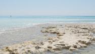 Sea waves on a rocky beach. Mediterranean sea, Tuscany, Italy. 4K UHD Stock Footage