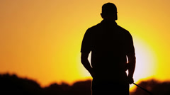 Golfer Silhouette Setting Sun Background - stock footage