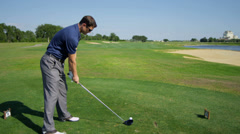 Golf Professional Teeing Off Golf Course Fairway - stock footage