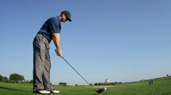 Stock Video Footage of Professional Golfer Teeing Off Start of Hole