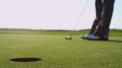 Golfer Holing Ball Using Putter Close Up Stock Footage