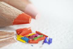 Stock Photo of color pencils shavings on white paper