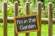 Stock Photo of blackboard with the inscription i am in the garden