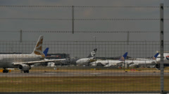 Planes on busy runway at Heathrow wait to take off timelapse  HD.MP4 Stock Footage
