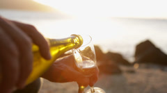 Pouring a glass of champagne at sunset Stock Footage