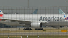 Thai and american airlines planes on runway 4k Stock Footage