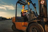 Female worker driving cargo truck Stock Photos
