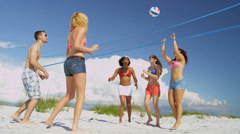 College Friends Laughing Enjoying Beach Volleyball Stock Footage