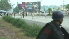 Islamabad Police being chased by Protesters Stock Footage