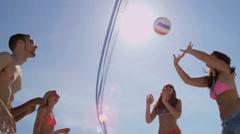 Teenagers Enjoying Game Beach Volleyball Stock Footage