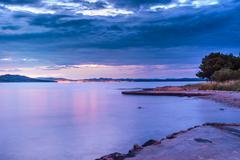 Dalmatia sunset in bay Stock Photos