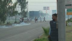 Islamabad Police fire Teargas at Protesters - stock footage