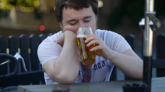 Depressed Young Adult Drinks Beer Stock Footage