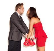 Boyfriend restraining girlfriend from fighting Stock Photos
