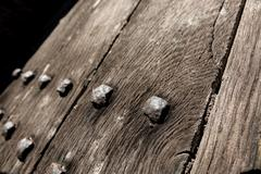 studded oak door - stock photo