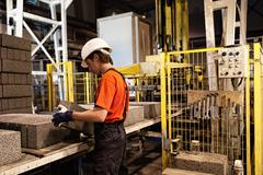factory loader at work.... - stock photo