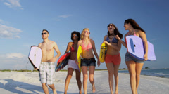 Young College Students Body Boards Enjoying Weekend Break - stock footage