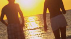 Teenagers Silhouette Dancing Beach Sunset - stock footage
