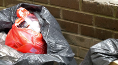 A black trash bag with garbage gh4 Stock Footage