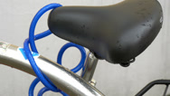Stock Video Footage of a bike seat with a blue cord or whire gh4
