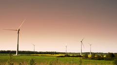Five windmills in a field on a late afternoon fs700 odyssey 7q Stock Footage
