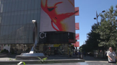 Modern shopping building, mall area, billboards view, people walking relaxed Stock Footage
