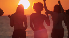 Stock Video Footage of Teenagers Enjoying Fun Beach Sunset