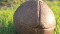 Dolly shot nose of football lying in grass Stock Footage