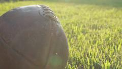 Dolly shot with football at sunset Stock Footage