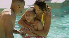 Happy Ethnic Family Vacation Rental Swimming Pool Stock Footage