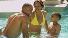 Happy Ethnic Family Vacation Rental Swimming Pool - stock footage