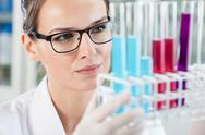 Stock Photo of woman looking at test tubes