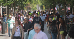4K Busy tree lined pedestrian street in Madrid, Spain Stock Footage