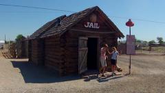 1860 Arizona Territorial Jail Replica With Kids- Seligman AZ Stock Footage