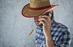 Farmer with cowboy straw hat Stock Photos