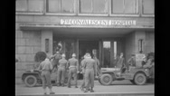 Military soldiers talking outside a hospital Stock Footage
