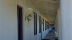 Looking Down Long Row Of Generic Motel Room Doors Windows Stock Footage
