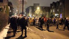 Riot police following protesters with flags Stock Footage