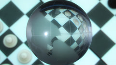 Globe on a checkerboard background Stock Footage