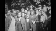 Group of refugees looking at the camera and refugees unpacking Stock Footage