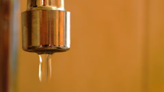 Water Leaking from the Tap. Open Tap. Economic Waste Concept. Stock Footage