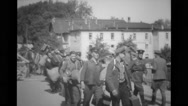 Refugees walking with luggage and military soldiers supervising Stock Footage