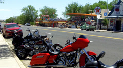 Parked Motorcycles With Route 66 Businesses- Seligman AZ Stock Footage