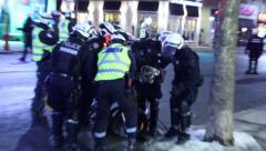 Man on bicycle arrested by riot officers - stock footage